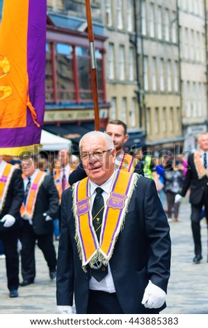 EDINBURGH, SCOTLAND - JUNE 25, 2016: Male member of the Orange Order during the procession up the Royal Mile to mark the twelfth of July events