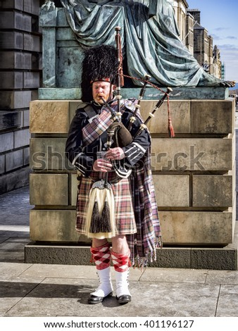 EDINBURGH, SCOTLAND - MARCH 6, 2016: Bagpipe player with a traditional uniform on Royal Mile in Edinburgh