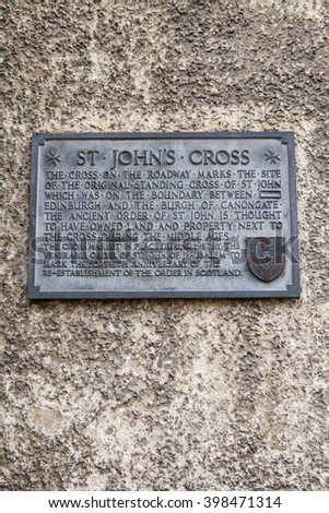 EDINBURGH, SCOTLAND - MARCH 8TH 2016: A wall plaque on Canongate, detailing the former site of the original St. Johns Cross along the Royal Mile in Edinburgh,on 8th March 2016.