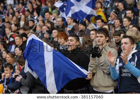 EDINBURGH, SCOTLAND-NOVEMBER 16, 2005: scottish rugby fans attending the Six Nations rugby match Scotland vs Italy, at the Murrayfield stadium, in Edinburgh.