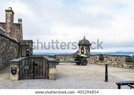 EDINBURGH, SCOTLAND - 22 SEPT 15 : The honor guard about to fire the famous Edinburgh cannon which shoots at one o' clock for correct time keeping at the castle - stock photo
