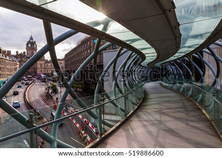 Edinburgh, Scotland - September 11, 2016: Leith Street Bridge. Its a modern pedestrian bridge in the old town that is with many Reformation-era buildings protected by UNESCO World Heritage Site