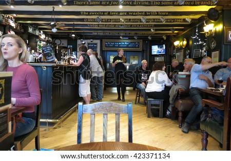 EDINBURGH, SCOTLAND, UK - CIRCA AUGUST 2015: Customers in a pub - stock photo