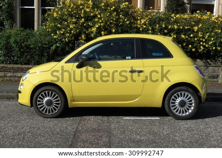 EDINBURGH; SCOTLAND, UK - CIRCA AUGUST 2015: yellow FIAT 500 car (new model) in a street of the city centre.