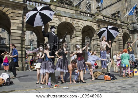 EDINBURGH, UK: AUGUST 2: Cast of Don Juan of Jackinabox Productions perform on the Royal Mile at the Edinburgh Festival Fringe in Edinburgh, UK on August 2, 2012 - stock photo