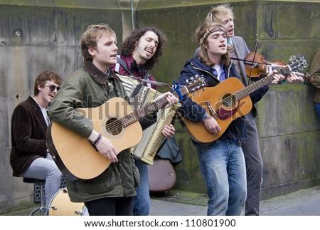 EDINBURGH, UK AUGUST 2: The Buffalo Skinners rock band play at the Edinburgh Festival Fringe in Edinburgh, UK on August 2, 2012 - stock photo