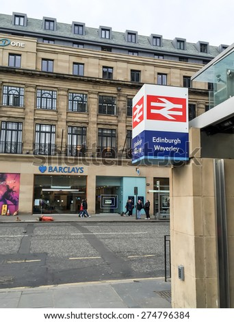 EDINBURGH, UNITED KINGDOM - APRIL 13, 2015: Waverley station entrance at Prince street in Edinburgh old town, UK. Edinburgh's Old Town and New Town together are listed as a UNESCO World Heritage Site. - stock photo