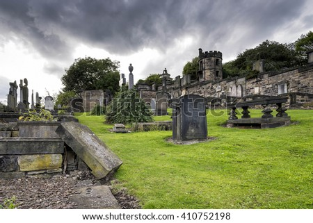 Edinburgh, United Kingdom - August 15, 2014: The Old Calton burial ground under dramatic sky. Located at Calton Hill, this burial ground, opened in 1718, is the resting place of several notable Scots. - stock photo