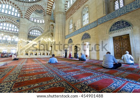 EDIRNE, TURKEY - JULY 12, 2016: People in interior of Selimiye Mosque on July 12, 2016 in Edirne, Turkey. Selimiye Mosque built in 1575 by Architect Sinan with the request of Suleyman the Magnificent. - stock photo