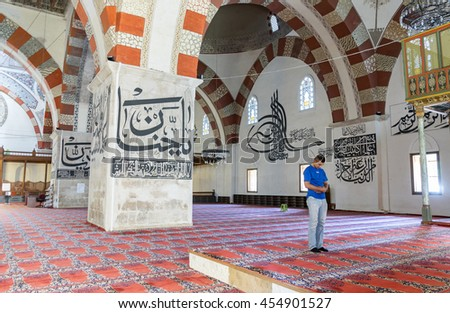 EDIRNE - TURKEY, JULY 12: Undefined muslims prayer in Edirne Old Mosque on july 12, 2016. The Old Mosque is an early 15th century Ottoman mosque in Edirne, Turkey