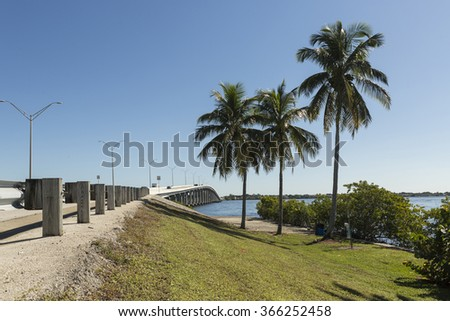 Edison Bridge with palms in Fort Myers, Southwest Florida. - stock photo