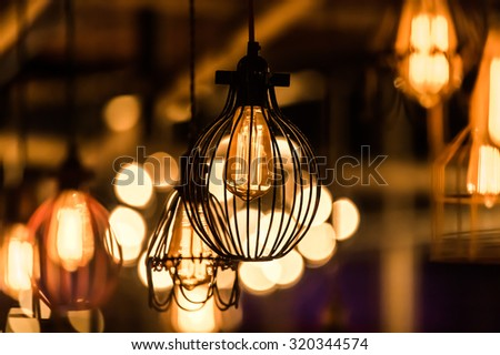 Edison light bulb decoration with retro bulbs - eclectic interior - stock photo