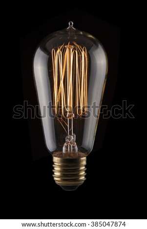 Edison Light bulb with Glowing Filament - stock photo