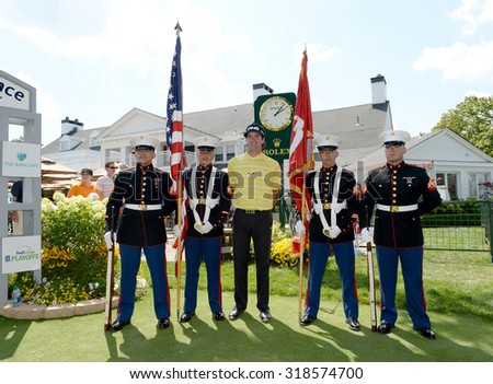 EDISON,NJ-AUGUST 25: Bubba Watson (c) proudly stands with the United States Marine Corps Color Guard during Military Appreciation Day held at the Plainfield Country Club in Edison,NJ,August 25,2015. - stock photo