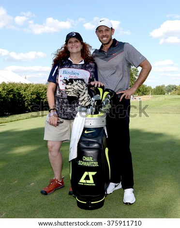 EDISON,NJ-AUGUST 26:Charl Schwartzel (r) with his Military Caddie during the Barclays Pro-Am held at the Plainfield Country Club in Edison,NJ,August 26,2015. - stock photo