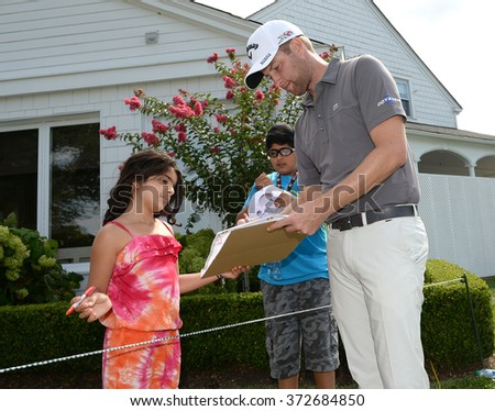 EDISON,NJ-AUGUST 26:Chris Kirk stops to give a fan his autograph during the Barclays Pro-Am held at the Plainfield Country Club in Edison,NJ,August 26,2015. - stock photo