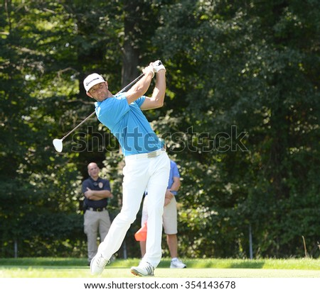 EDISON,NJ-AUGUST 25:Dustin Johnson watches his shot during the Barclays Tournament practice rounds held at the Plainfield Country Club in Edison,NJ,August 25,2015.