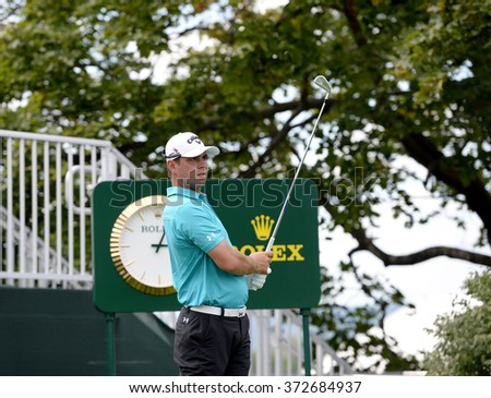 EDISON,NJ-AUGUST 26:Gary Woodland watches his shot during the Barclays Pro-Am held at the Plainfield Country Club in Edison,NJ,August 26,2015.