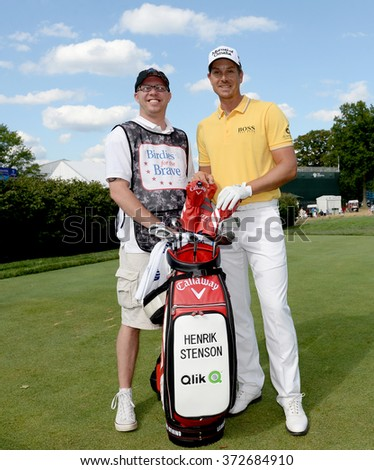 EDISON,NJ-AUGUST 26:Henrik Stenson (r) with his Military Caddie during the Barclays Pro-Am held at the Plainfield Country Club in Edison,NJ,August 26,2015. - stock photo