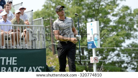 EDISON,NJ-AUGUST 30:Henrik Stenson watches his shot from the 1st Tee during the final round of the Barclays Tournament held at the Plainfield Country Club in Edison,NJ,August 30,2015. - stock photo