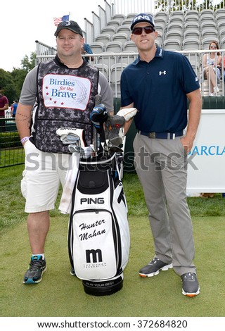 EDISON,NJ-AUGUST 26:Hunter Mahan (r) with his Military Caddie during the Barclays Pro-Am held at the Plainfield Country Club in Edison,NJ,August 26,2015. - stock photo