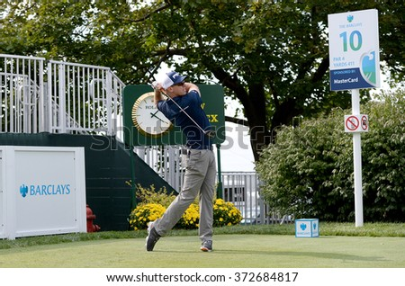 EDISON,NJ-AUGUST 26:Hunter Mahan watches his shot during the Barclays Pro-Am held at the Plainfield Country Club in Edison,NJ,August 26,2015.