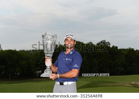 EDISON,NJ-AUGUST 30:Jason Day holds the Barclays winner's trophy on the 18th green after the final round of the Barclays Tournament held at the Plainfield Country Club in Edison,NJ,August 30,2015.