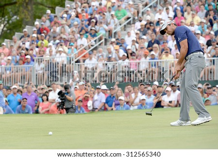 EDISON,NJ-AUGUST 30:Jason Day watches his putt on the 18th green during the final round of the Barclays tournament held at the Plainfield Country Club in Edison,NJ,August 30,2015.