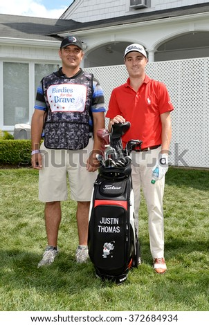 EDISON,NJ-AUGUST 26:Justin Thomas (r) with his MilitaryCaddie during the Barclays Pro-Am held at the Plainfield Country Club in Edison,NJ,August 26,2015. - stock photo