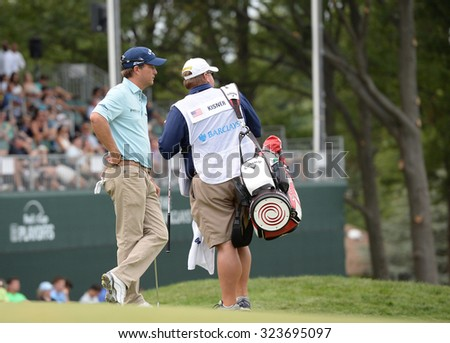 EDISON,NJ-AUGUST 30:Kevin Kisner (L) takes a look down the fairway from the 18th hole during the final round of the Barclays Tournament held at the Plainfield Country Club in Edison,NJ,August 30,2015.