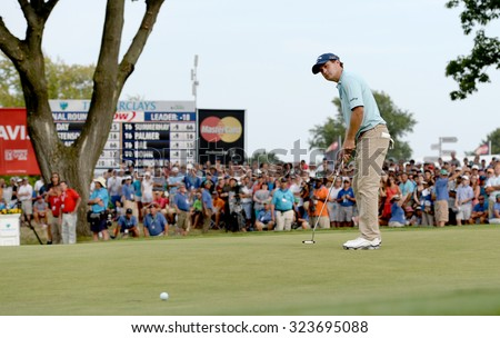 EDISON,NJ-AUGUST 30: Kevin Kisner watches his putt at the 18th hole during the final round of the Barclays held at the Plainfield Country Club in Edison,NJ,August 30,2015. - stock photo