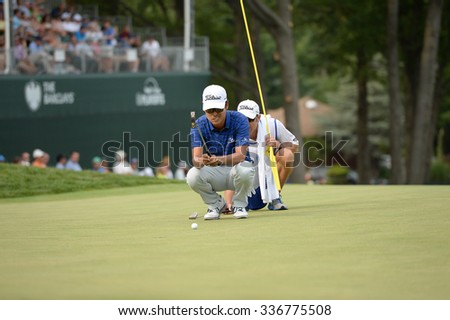 EDISON,NJ-AUGUST 30:Kevin Na (front) lines up his putt on the 18th Hole during the final round of the Barclays Tournament held at the Plainfield Country Club in Edison,NJ,August 30,2015.