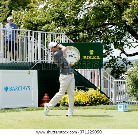 Edison,NJ-AUGUST 26:Russell Henley watches his shot during the Barclays Pro-Am held at the Plainfield Country Club in Edison,NJ,August 26,2015. - stock photo