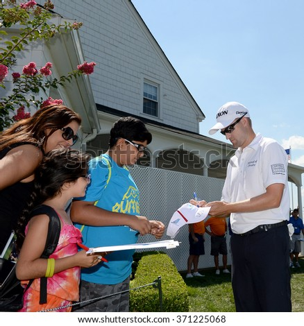 EDISON,NJ-AUGUST 26:Russell Knox stops to give a fan his autograph during the Barclays Pro-Am held at the Plainfield Country Club in Edison,NJ,August 26,2015. - stock photo