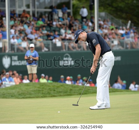 EDISON,NJ-AUGUST 30:Russell Knox watches his putt at the 18th hole during the final round of the Barclays Tournament held at the Plainfield Country Club in Edison,NJ,August 30,2015.