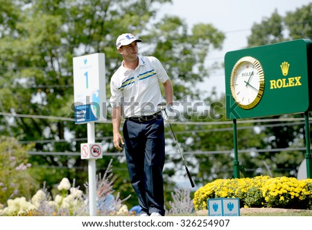 EDISON,NJ-AUGUST 30:Spencer Levin watches his shot from the 1st Tee during the final round of the Barclays Tournament held at the Plainfield Country Club in Edison,NJ,August 30,2015.