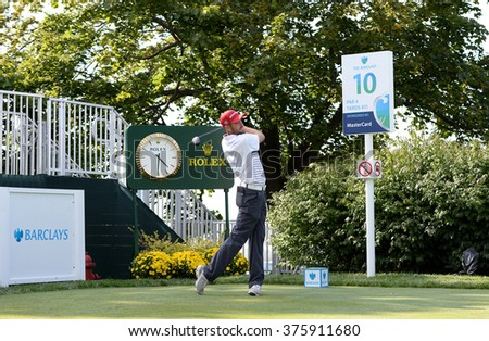 EDISON,NJ-AUGUST 26:Troy Merritt watches his shot during the Barclays Pro-Am held at the Plainfield Country Club in Edison,NJ,August 26,2015.