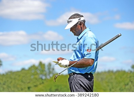 EDISON,NJ-AUGUST 28:Vijay Singh checks his score card during the second round of the Barclays Tournament held at the Plainfield Country Club in Edison,NJ,August 28,2015. - stock photo