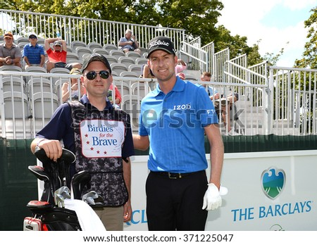 EDISON,NJ-AUGUST 26:Webb Simpson (r) with his Military Caddie during the Barclays Pro-Am held at the Plainfield Country Club in Edison,NJ,August 26,2015.