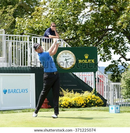 EDISON,NJ-AUGUST 26:Webb Simpson watches his shot during the Barclays Pro-Am held at the Plainfield Country Club in Edison,NJ,August 26,2015. - stock photo