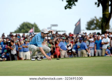 EDISON,NJ-AUGUST 30: Zach Johnson lines up his ball at the 18th hole during the final round of the Barclays Tournament held at the Plainfield Country Club in Edison,NJ,August 30,2015. - stock photo
