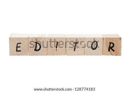 Editor spellled out using wooden blocks on white background.