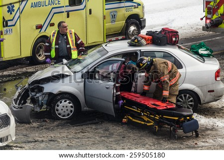 Editorial - Longueuil, Quebec, Canada on March 4th 2015 during the winter. Car accident caused by bad signalisation at Intersection. - stock photo