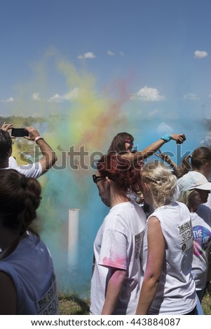 Editorial photograph. Color run event Budapest 18.06.2016. Portraits. Crowds of people racing in a fun competition. with the participation of almost 6000 participants.