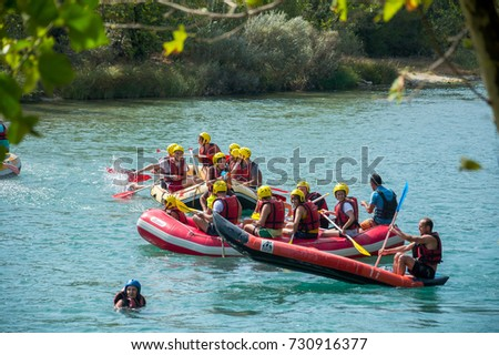 Editorial. September 10, 2017. Manavgat, Turkey. A group of men and women are rafting on the river, extreme sport. Tourists-extremals in helmets and waistcoats rowing in a boats