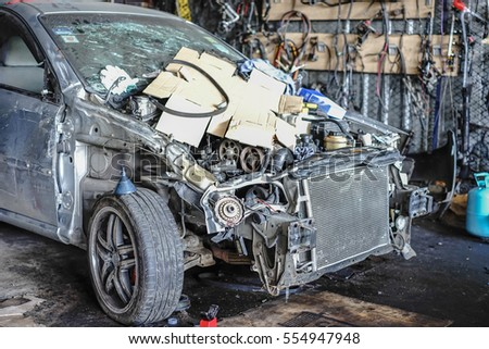 Editorial use only; Crashed car in a repair shop at Ramintra, Bangkok, Thailand on January 12th, 2017.