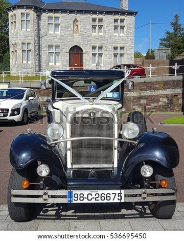 Editorial use only; Vintage wedding car at St. Colemans's Cathedral, Cobh. Cork , Ireland. Taken on September 2nd 2016.