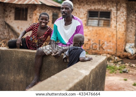 Editorial use. People in Africa face poor life conditions and health issues. However, they are family oriented and keep children close to home. Zanzibar Island, Tanzania, April 2016