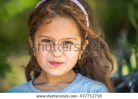 Editorial use. The Tatars are Turkic people striving to keep their traditions in small communities in Eastern Europe. Image of a Tatar girl taken in the remote village of Hagieni, Romania, June 2016.