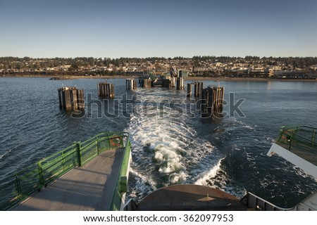 Edmonds, Washington Ferry Dock. A ferry boat pull out of the ferry dock traveling to Kingston on Bainbridge Island in the Puget Sound area of western Washington state.